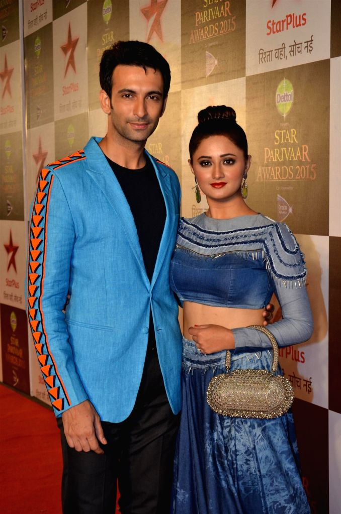 Television actors Rashmi Desai and Nandish Sandhu during the Star Parivaar Awards 2015, in Mumbai on May 17, 2015. - Rashmi Desai and Nandish Sandhu