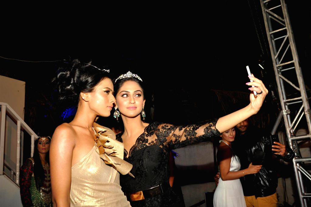 Televisions actor Nia Sharma and Krystle D'Souza during the launch of Telly Calender 2015 in Mumbai, on Dec 23, 2014. - Nia Sharma