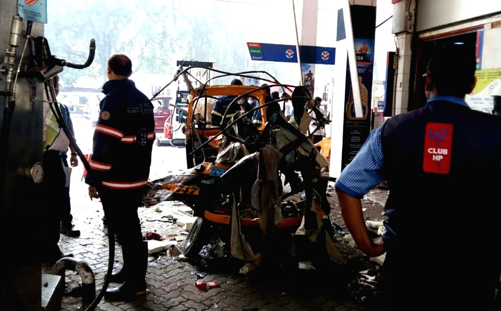 :Mumbai: The charred remains of an auto rickshaw where a CNG cylinder blasted at a petrol pump in Mumbai's Kandivali on Oct 20, 2018. Three persons were reportedly injured in the incident. ...