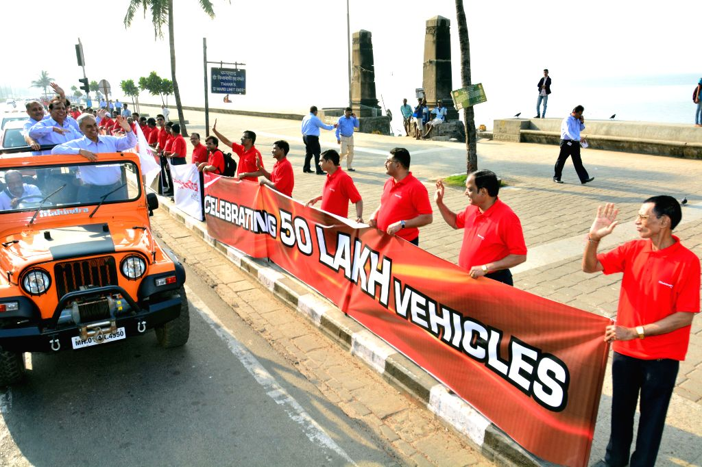 The employees of Mahindra & Mahindra Limited form a human chain  from Nariman Point to Girgam Chowpaty to mark the roll out of 50,00,000th vehicle of the company on Jan 5, 2015.