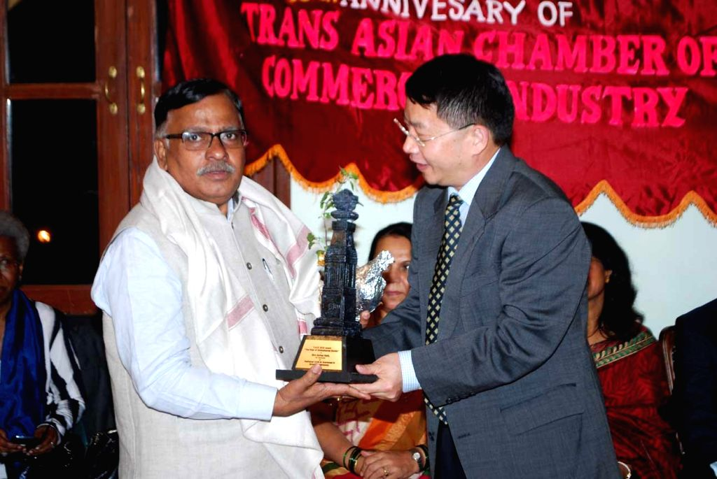 The Programme Coordinator (Scientific) of Nehru Planetarium Mumbai, Suhas B Naik Satam being conferred `Pillar of Hindustani Society Award - 2014-15` for Astronomy Awareness, by the Chinese ...