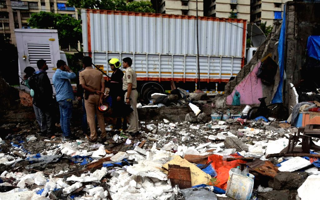 Mumbai: The site where a wall collapsed following heavy rains, near Kamgar Krida Maidan in Mumbai on June 28, 2019. Reportedly, three persons were injured in the incident. (Photo: IANS)