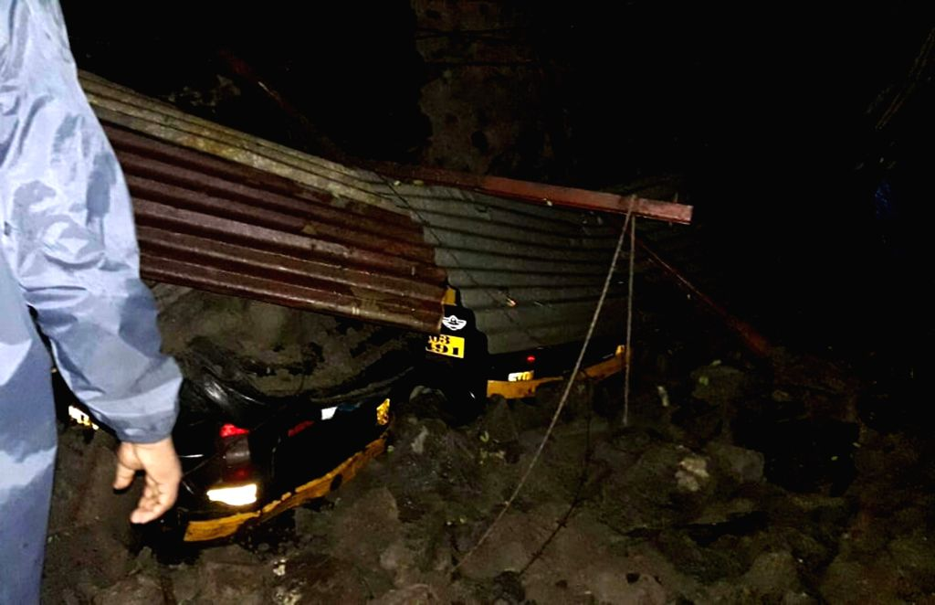 Mumbai: The site where a wall collapsed on auto rickshaws at around 2 am in the midnight, in Mumbai's Chembur on June 29, 2019. No causalities have been reported. (Photo: IANS)