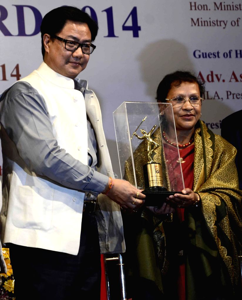 The Union Minister of State for Home Affairs Kiren Rijiju confers ONE India Award 2014 to writer, social science researcher and the editor of The Shillong Times, Patricia Mukhim in Mumbai, on