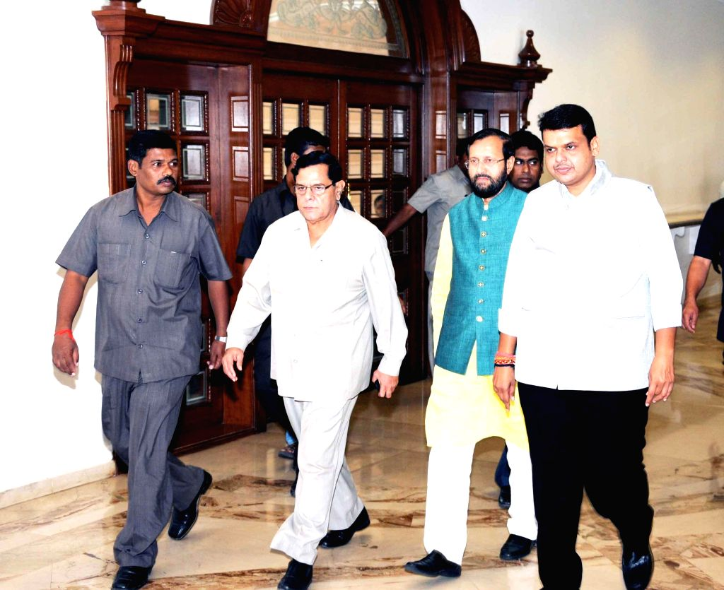 The Union MoS for Information and Broadcasting (I/C), Environment, Forest and Climate Change (I/C) and Parliamentary Affairs, Prakash Javadekar and Maharashtra Chief Minister Devendra ...
