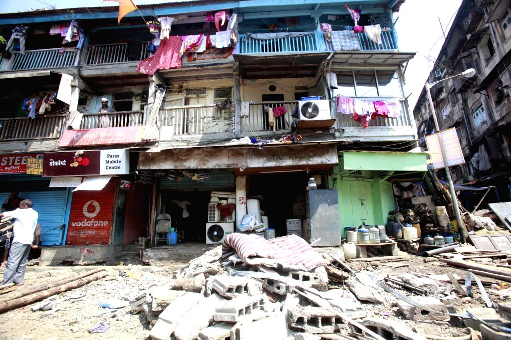 Three people were injured after the second floor of a building collapsed in Kamathipura, of Mumbai on March 11, 2015.