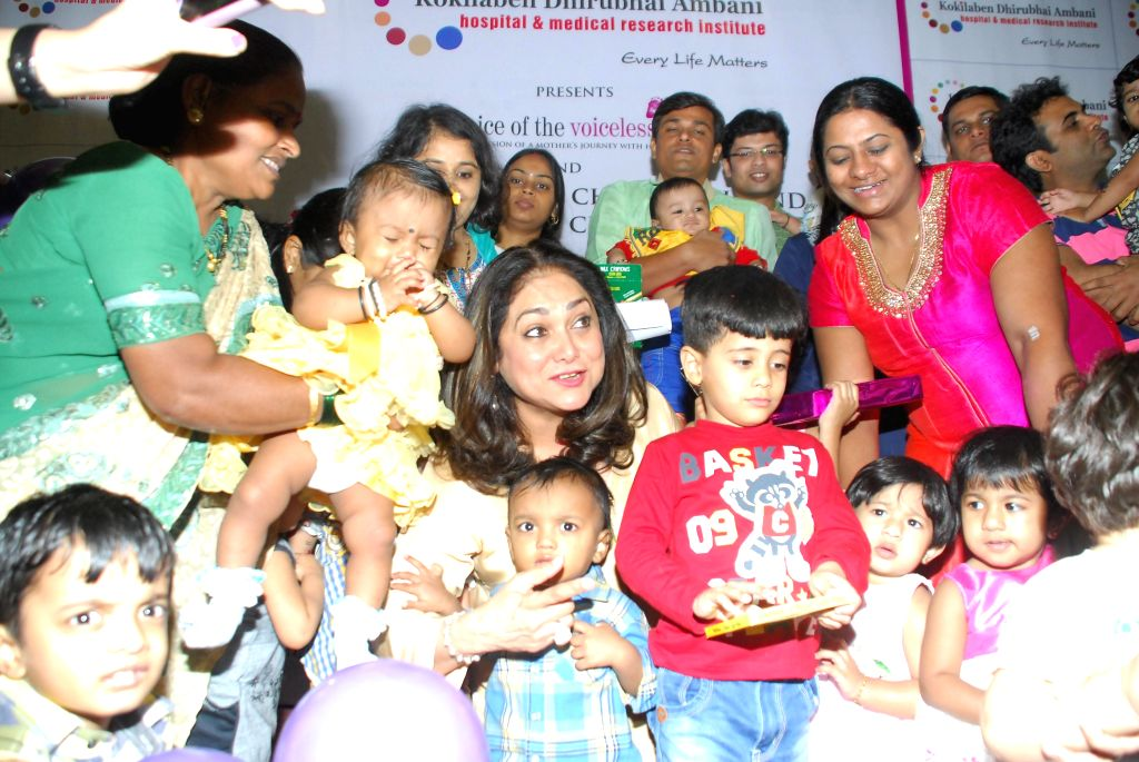 Tina Ambani, wife of Anil Ambani, chairman of Anil Dhirubhai Ambani Group with a premature kid during an interactive session on Child Birth and its Myriad Challenges with mothers and their ... - Dhirubhai Ambani Group