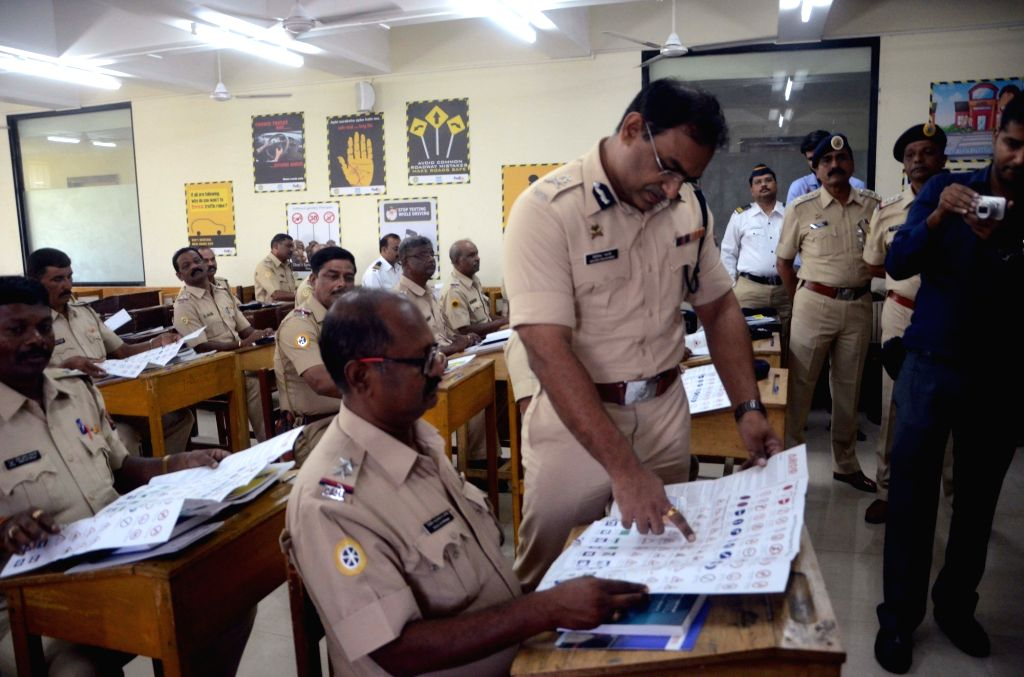 Mumbai Traffic Police officers attend a Road Safety training programme organised by Mumbai Traffic Police and Institute of Road Traffic Education (IRTE) at Traffic Guidance Centre, Byculla in Mumbai on Oct 13, 2016. (Photo: IANS)