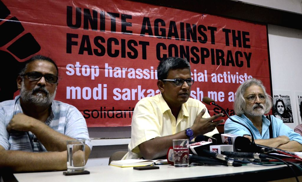 Tushar Gandhi, journalist Dilip D'Souza and documentary filmmaker Anand Patwardhan addresses a press conference in support of social activist Teesta Setalvad in Mumbai, on Feb 17, 2015. - Tushar Gandhi