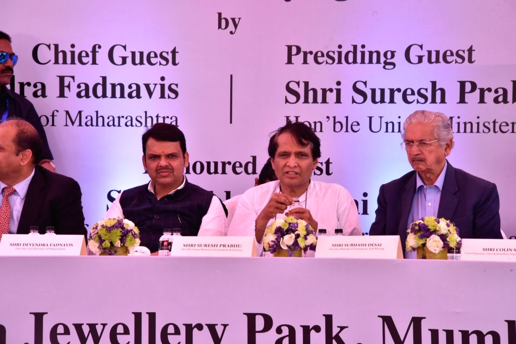 Mumbai: Union Commerce Minister Suresh Prabhu, Maharashtra Chief Minister Devendra Fadnavis and Industry Minister Subhash Desai during the foundation stone laying ceremony for the proposed India Jewellery Park (IJP) in Navi Mumbai on March 5, 2019. ( - Suresh Prabhu and Subhash Desai