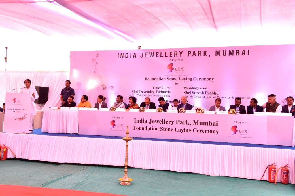 Mumbai: Union Commerce Minister Suresh Prabhu, Maharashtra Chief Minister Devendra Fadnavis, Industry Minister Subhash Desai and and Gem & Jewellery Export Promotion Council (GJEPC) Chairman P. K. Agarwal during the foundation stone laying ceremony f - Suresh Prabhu and Subhash Desai