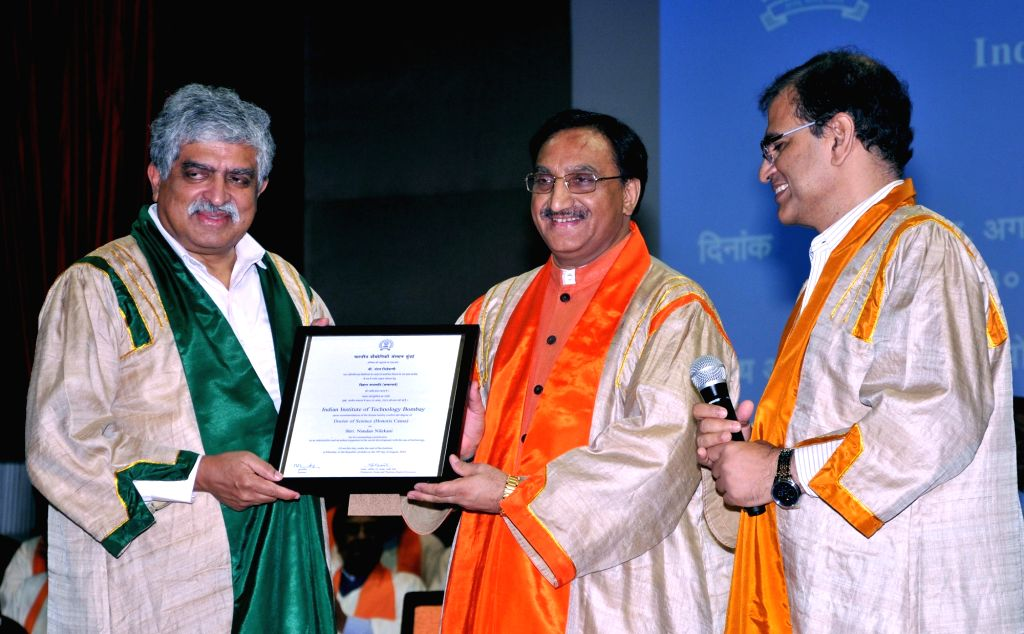 Mumbai: Union Human Resource Development Minister Ramesh Pokhriyal Nishank confers the degree of Doctor of Science on Infosys Technologies limited, Bangalore Co-founder and Chairman  and Former UIDAI Chairman Nandan Nilekani, at the 57th convocation  - Ramesh Pokhriyal Nishank