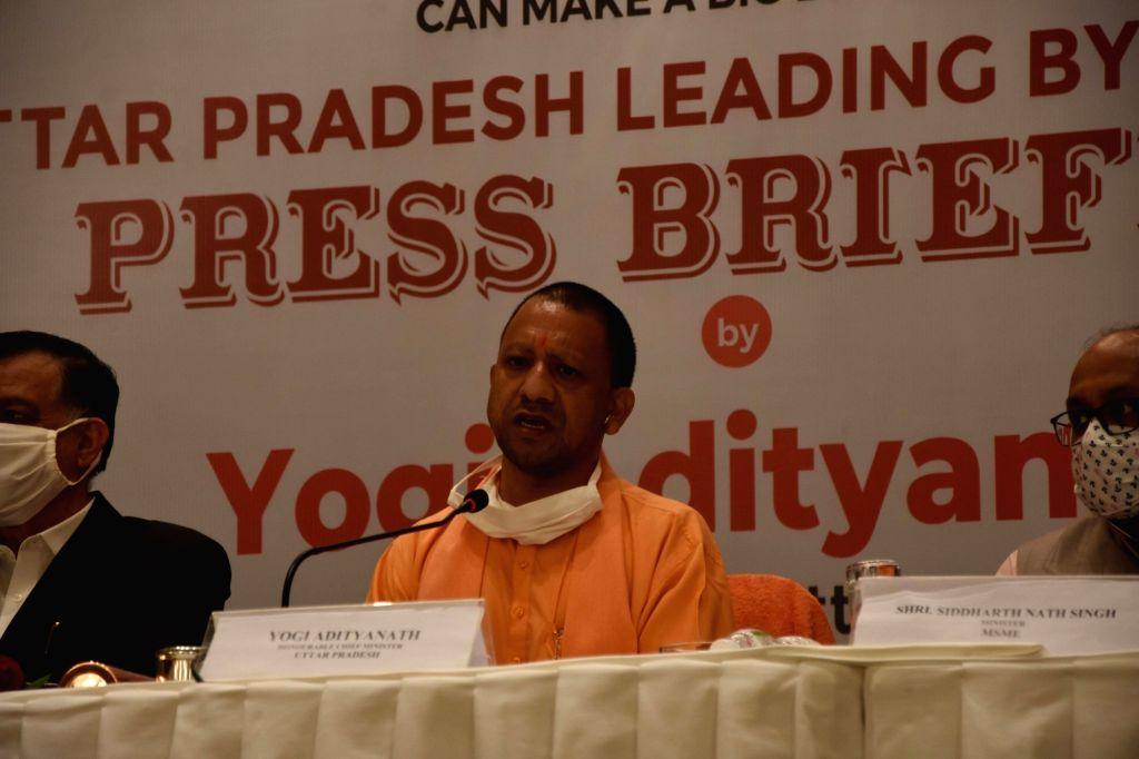 Mumbai: Uttar Pradesh Chief Minister Yogi Adityanath addresses a press briefing in Mumbai on Dec 2, 2020. Yogi Adityanath rang the bell at the Bombay Stock Exchange (BSE) marking the listing of bonds of the Lucknow Municipal Corporation (LMC), here o - Yogi Adityanath