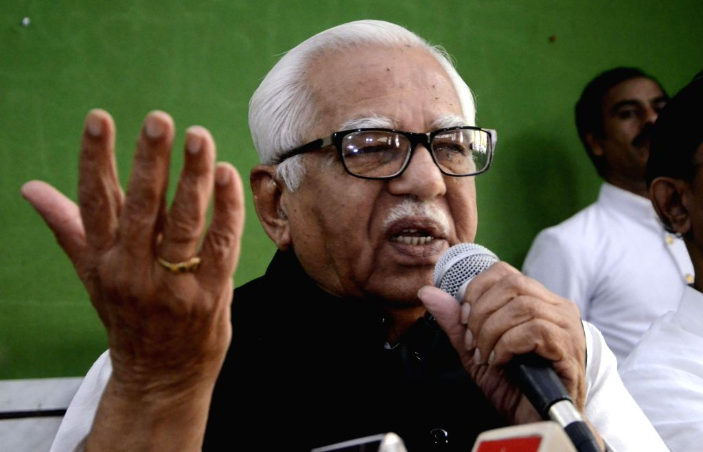 Mumbai: Uttar Pradesh Governor Ram Naik addresses a press conference in Mumbai, on March 9, 2015. (Photo: Sandeep Mahankal/IANS)
