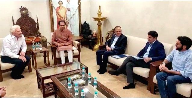 Mumbai: Virgin Group founder Richard Branson meets Maharashtra Chief Minister Uddhav Thackeray over the $10 billion Mumbai-Pune Hyperloop project, in Mumbai on Dec 12, 2019. Also seen Chief Minister Uddhav Thackeray's son Aditya Thackeray. (Photo: IA - Uddhav Thackeray