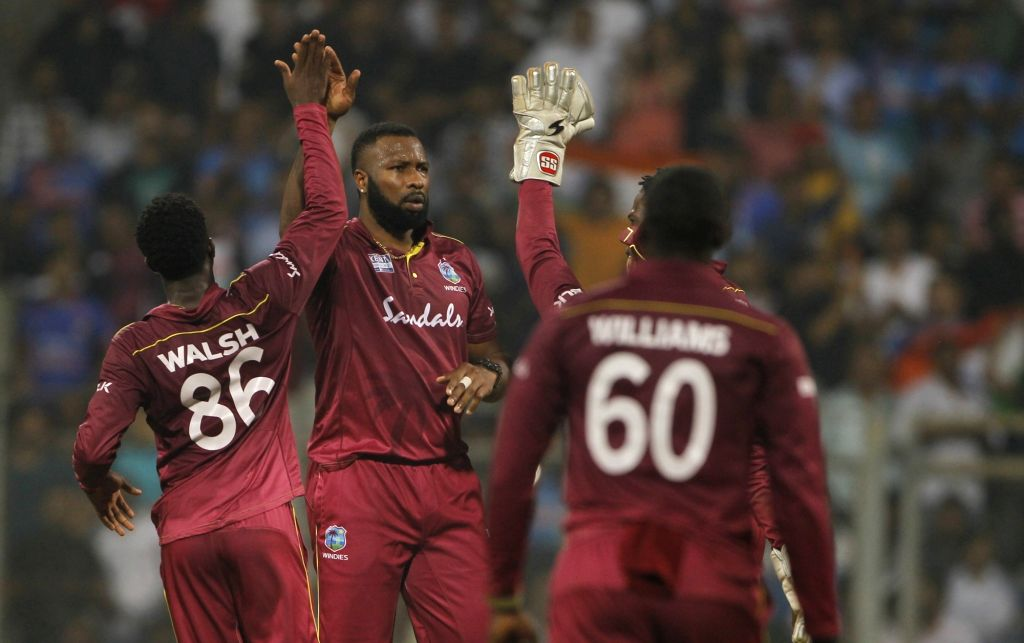 Mumbai: West Indies captain Kieron Pollard celebrates the wicket of Rishabh Pant during the third T20I match between India and West Indies at Wankhede Stadium in Mumbai on Dec 11, 2019. (Photo: Surjeet Yadav/IANS) - Kieron Pollard and Surjeet Yadav