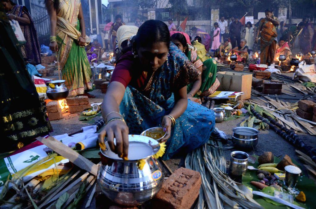 Women celebrate `Pongal` at Dharavi in Mumbai on Jan.14, 2015.