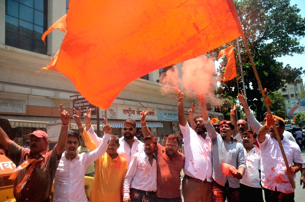 Mumbai: Workers of Shiv Sena (an ally of the BJP led NDA) celebrate after the BJP led by Prime Minister Narendra Modi was set to retain power for another five years after making a sweep of the Lok Sabha battle and mauling the opposition; in Mumbai on - Narendra Modi