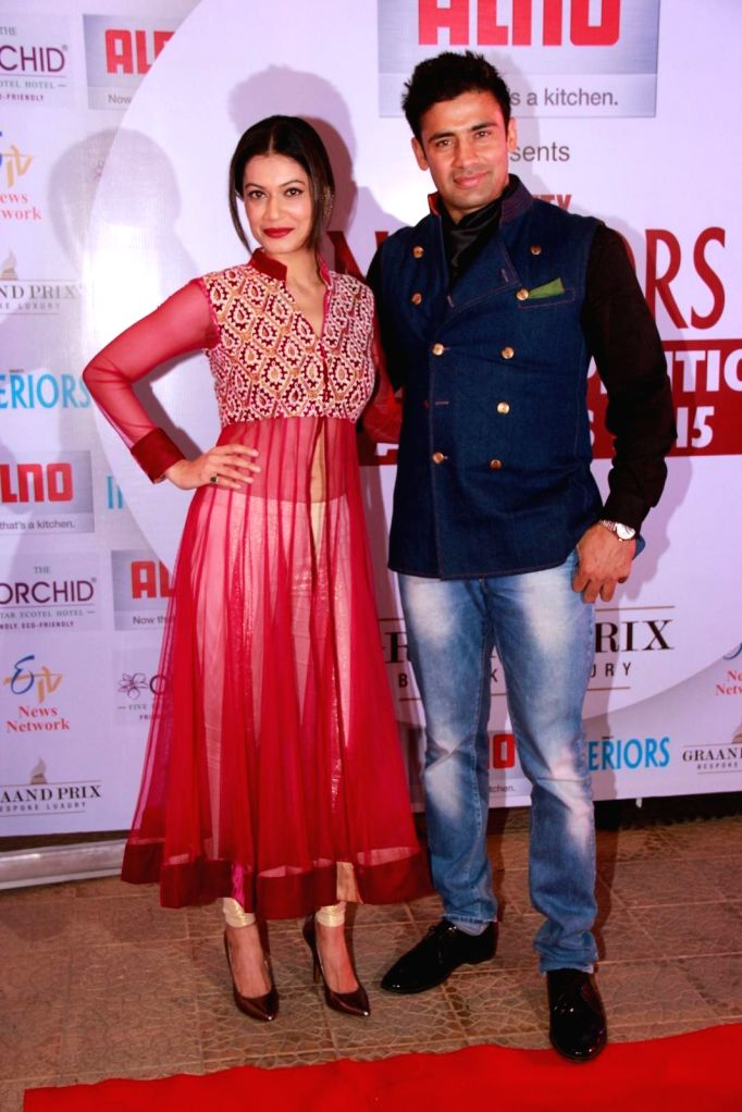 Wrestler Sangram Singh with his wife Payal Rohatgi during the 13th Society Interiors Design Competition and Awards in Mumbai on Feb 21, 2015. - Sangram Singh
