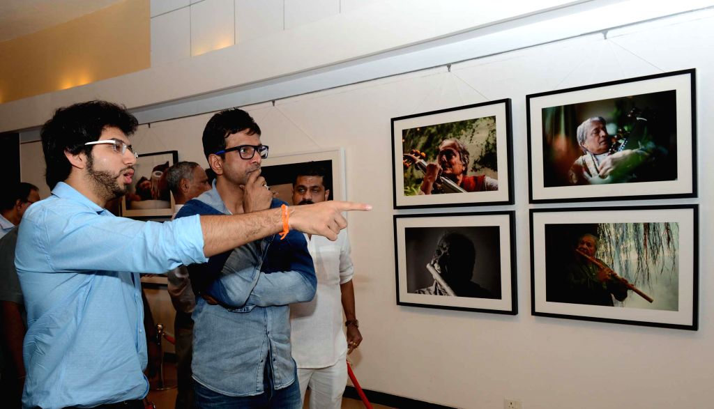 Yuva Sena chief Aditya Thackeray with actor Jaaved Jaffrey at the photography exhibition of Shiv Sena Chief Uddhav Thackeray, organised to raise funds for drought affected farmers, in Mumbai, - Jaaved Jaffrey