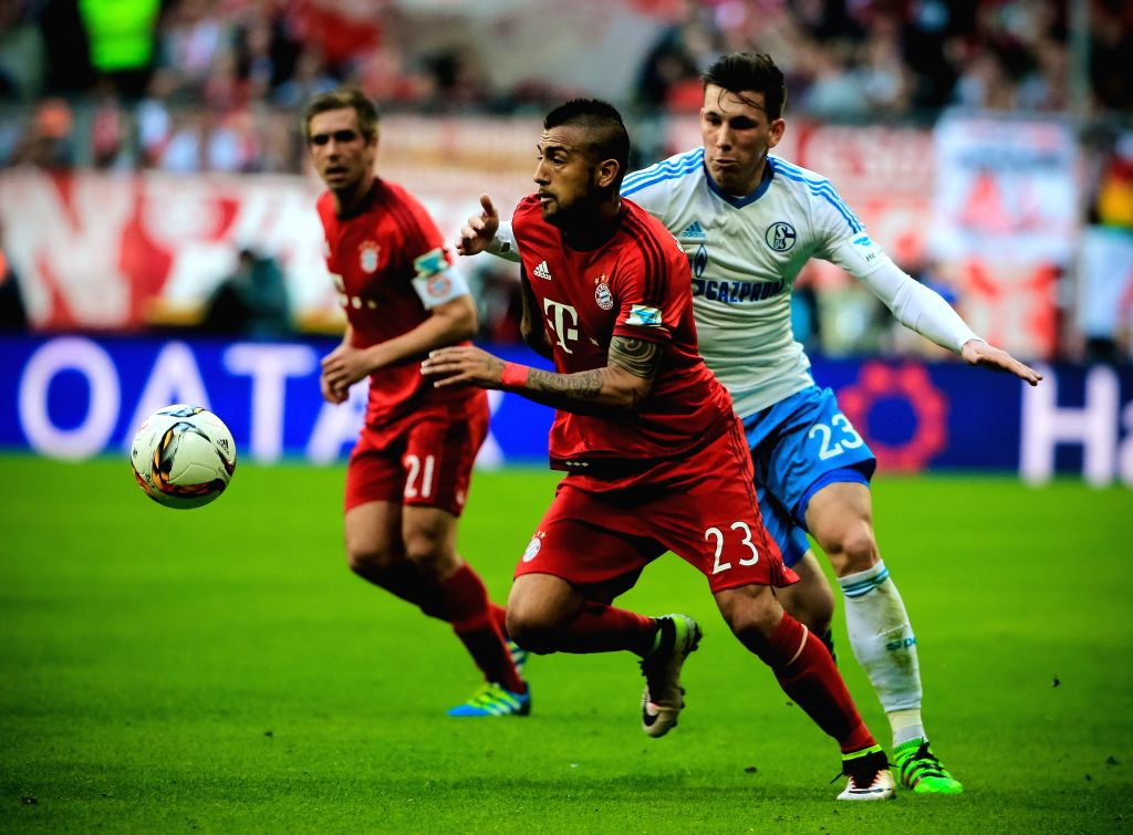 MUNICH, April 17, 2016 - Arturo Vidal (C) of Bayern Munich vies for the ball during the German first division Bundesliga football match against Schalke 04 in Munich, Germany, on April 16, 2016. ...