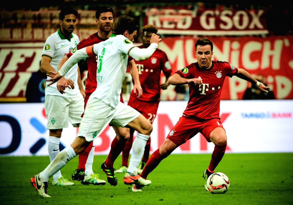 MUNICH, April 20, 2016 - Mario Goetze (1st R) of Bayern Munich competes during the German Cup semifinal match against Werder Bremen in Munich, Germany, April 19, 2016. Bayern Munich won 2-0 and ...
