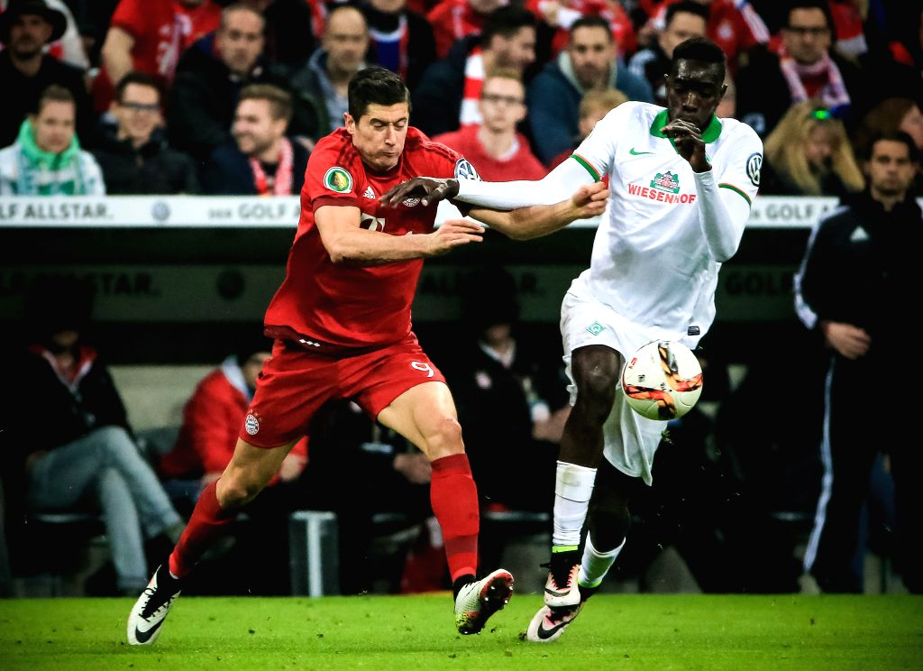 MUNICH, April 20, 2016 - Robert Lewandowski (L) of Bayern Munich competes during the German Cup semifinal match against Werder Bremen in Munich, Germany, April 19, 2016. Bayern Munich won 2-0 and ...