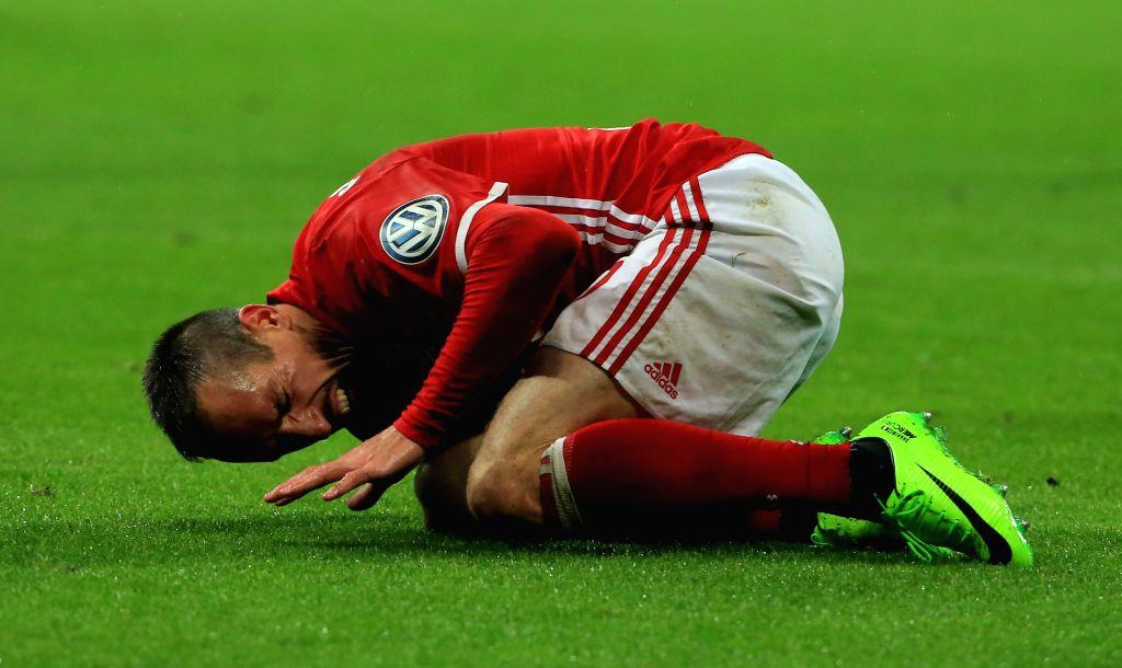 MUNICH, April 27, 2017 - Bayern Munich's Franck Ribery falls down during a semifinal match of German Cup between Bayern Munich and Borussia Dortmund in Munich, Germany, on April 26, 2017. Borussia ...