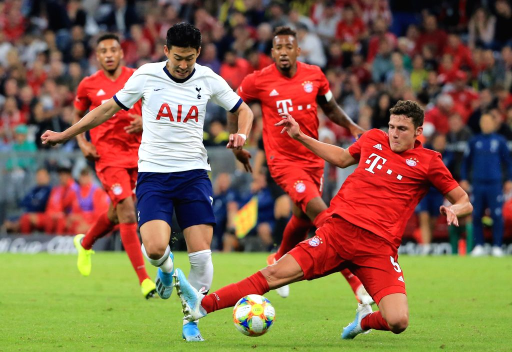 MUNICH, Aug. 1, 2019 - Benjamin Pavard (front R) of Bayern Munich vies with Son Heung-min (front L) of Tottenham Hotspur during the final match of Audi Cup between Tottenham Hotspur of England and FC ...