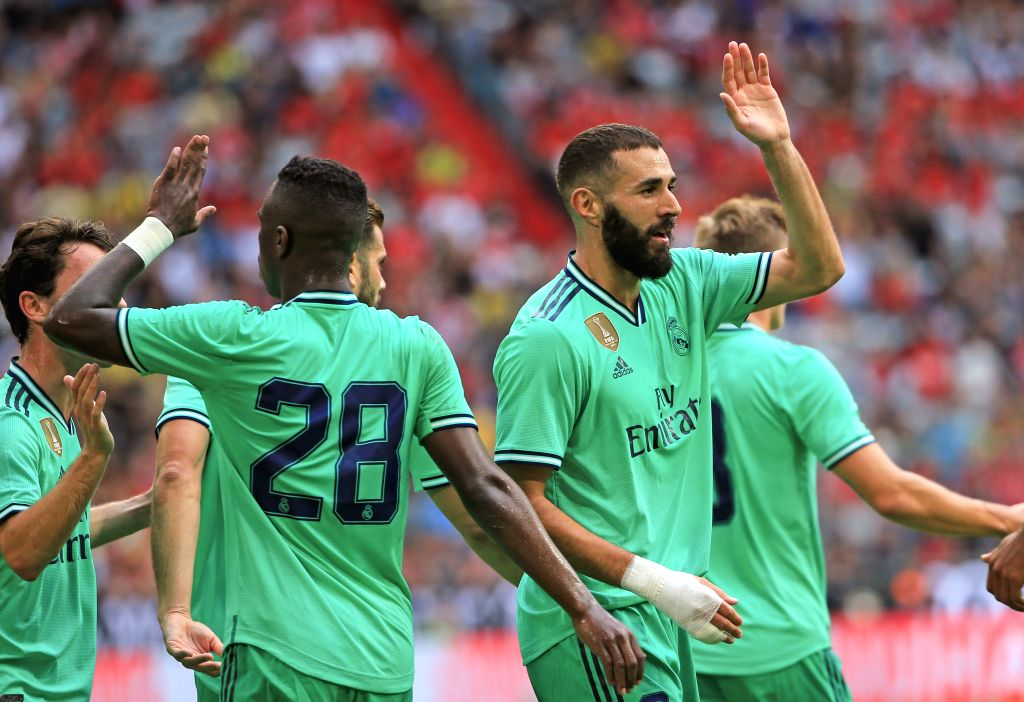 MUNICH, Aug. 1, 2019 - Karim Benzema (R) of Real Madrid celebrates his second goal during the third place playoff of Audi Cup between Real Madrid of Spain and Fenerbahce SK of Turkey in Munich, ...