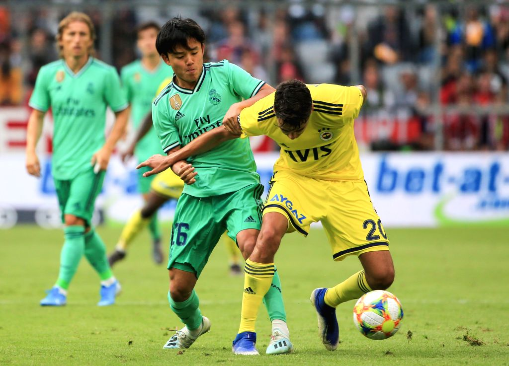 MUNICH, Aug. 1, 2019 - Takefusa Kubo (front L) of Real Madrid vies with Diego Reyes of Fenerbahce during the third place playoff of Audi Cup between Real Madrid of Spain and Fenerbahce SK of Turkey ...