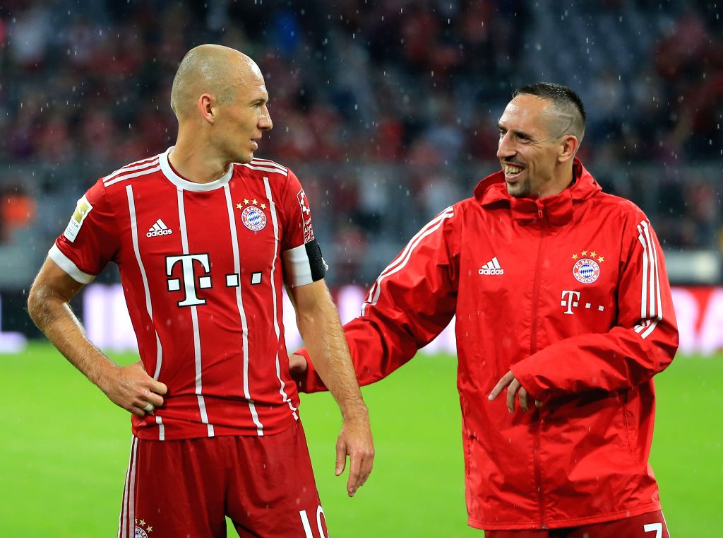 MUNICH, Aug. 19, 2017 - Bayern Munich's Franck Ribery (R) and Arjen Robben react after a German Bundesliga match between Bayern Munich and Bayer 04 Leverkusen in Munich, Germany, on Aug. 18, 2017. ...