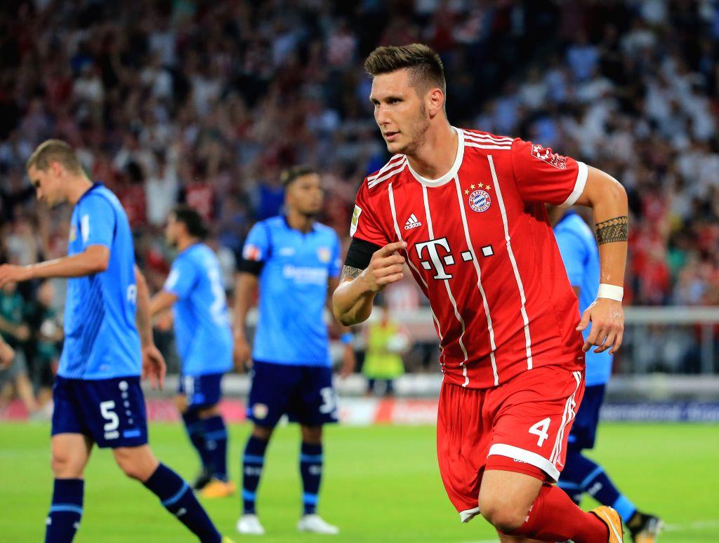 MUNICH, Aug. 19, 2017 - Bayern Munich's Niklas Suele celebrates after scoring during a German Bundesliga match between Bayern Munich and Bayer 04 Leverkusen in Munich, Germany, on Aug. 18, 2017. ...