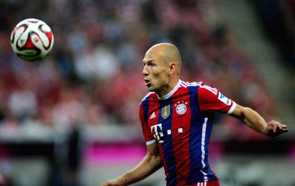 Bayern Munich's Arjen Robben attacks during the German first division Bundesliga football match between Bayern Munich and Wolfsburg in Munich, Germany, on Aug. 22, ..