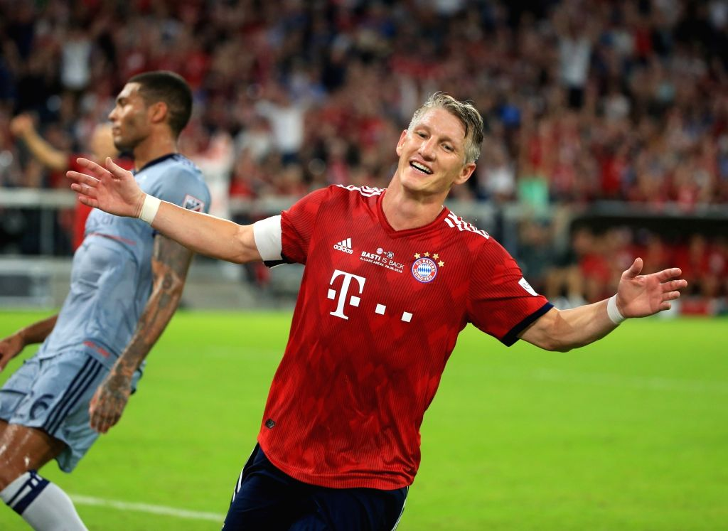 MUNICH, Aug. 29, 2018 (Xinhua) -- German player Bastian Schweinsteiger (R) celebrates after scoring during his farewell match between Bayern Munich of Germany and Chicago Fire of the United States, in Munich, Germany, on Aug. 28, 2018. A Farewell mat