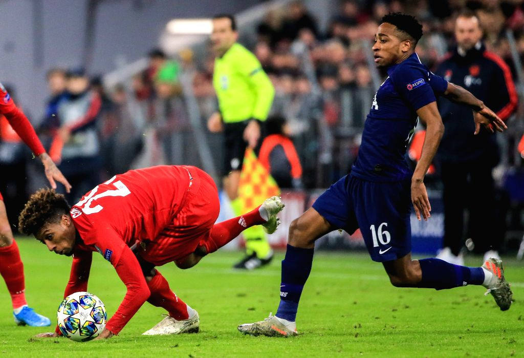 MUNICH, Dec. 12, 2019 - Kingsley Coman (L) of Bayern Munich vies with Kyle Walker-Peters of Tottenham Hotspur during a UEFA Champions League Group B match between FC Bayern Munich of Germany and ...