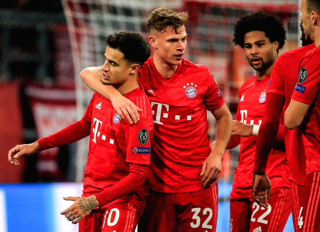 MUNICH, Dec. 12, 2019 - Philippe Coutinho (1st L) of Bayern Munich celebrates scoring with his teammate Joshua Kimmich (2nd L) during a UEFA Champions League Group B match between FC Bayern Munich of ...