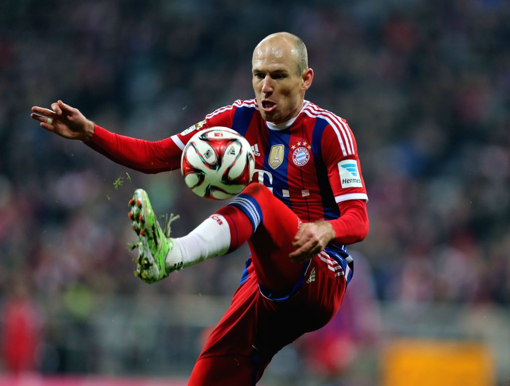 Bayern Munich's Arjen Robben vies for the ball during the German first division Bundesliga football match between Bayern Munich and Freiburg in Munich, Germany, on ..