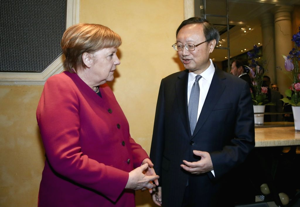 MUNICH, Feb. 17, 2019 - German Chancellor Angela Merkel (L) meets with Yang Jiechi, a member of the Political Bureau of the Communist Party of China (CPC) Central Committee and director of the Office ...