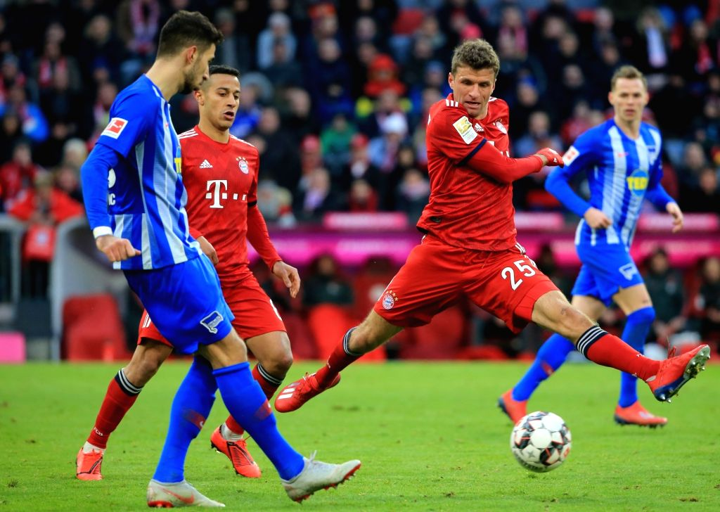 MUNICH, Feb. 24, 2019 (Xinhua) -- Bayern Munich's Thomas Mueller (2nd R) intercepts the pass from Hertha's Marko Grujic (1st L) during a German Bundesliga match between Bayern Munich and Hertha Berlin in Munich, Germany, Feb. 23, 2019. (Xinhua/Philip