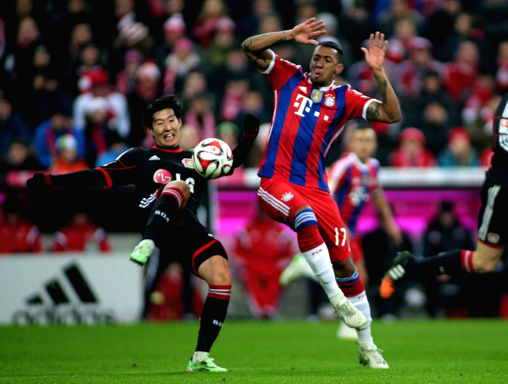 Munich (Germany): Bayern Munich's Jerome Boateng (R) vies for the ball during the German first division Bundesliga football match between Bayern Munich and Leverkusen in Munich, Germany, on Dec. 6, ..