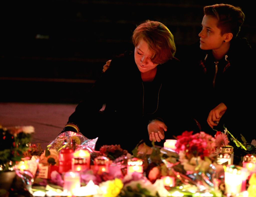 MUNICH (GERMANY), July 24, 2016 People light candles to mourn the Friday shootout victims in front of the Olympia shopping mall in Munich, Germany, on July 23, 2016. An 18-year-old ...