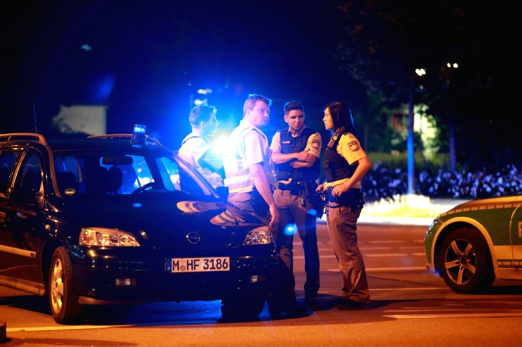 MUNICH, July 23, 2016 - Police officers secure the area near the Olympia shopping mall in Munich, Germany, on July 22, 2016. Nine people were killed and 16 others injured in a shooting attack in ...