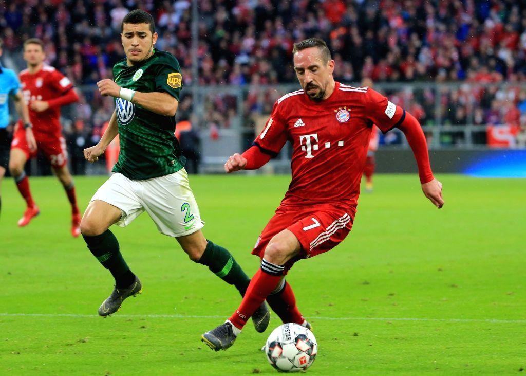 MUNICH, March 10, 2019 - Bayern Munich's Franck Ribery (R) controls the ball during a German Bundesliga match between FC Bayern Munich and VfL Wolfsburg, in Munich, Germany, on March 9, 2019. Bayern ...