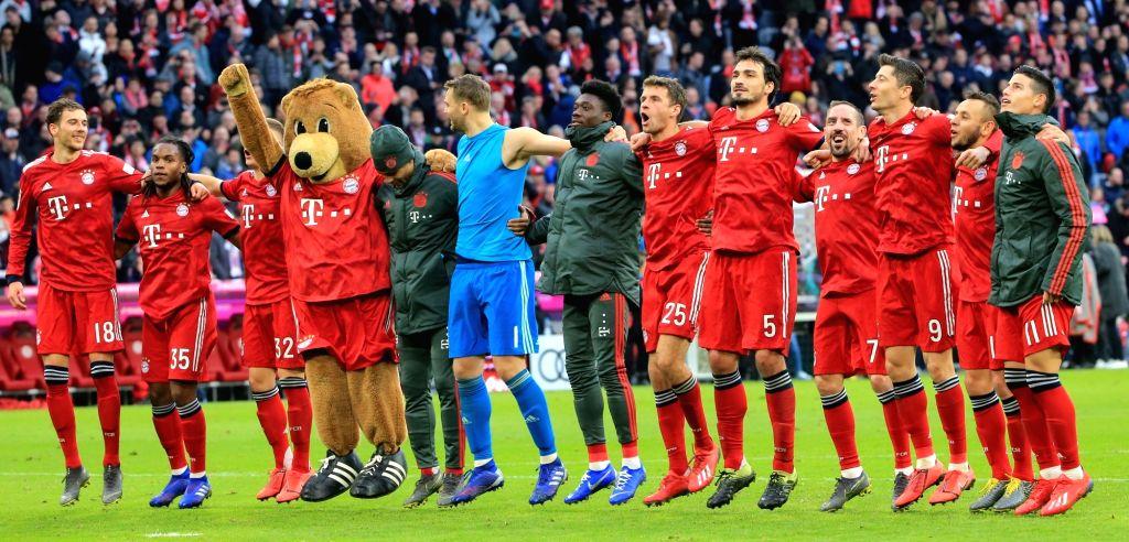 MUNICH, March 10, 2019 - Bayern Munich's players greet the fans after a German Bundesliga match between FC Bayern Munich and VfL Wolfsburg, in Munich, Germany, on March 9, 2019. Bayern Munich won 6-0.
