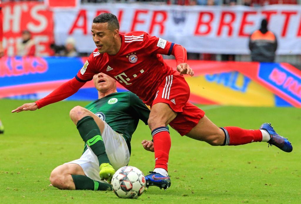 MUNICH, March 10, 2019 - Bayern Munich's Thiago Alcantara (R) competes during a German Bundesliga match between FC Bayern Munich and VfL Wolfsburg, in Munich, Germany, on March 9, 2019. Bayern Munich ...
