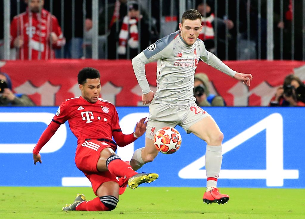 MUNICH, March 14, 2019 - Liverpool's Andrew Robertson (R) vies with Bayern Munich's Serge Gnabry during the UEFA Champions League 1/8 finals second leg match between Bayern Munich of Germany and ...