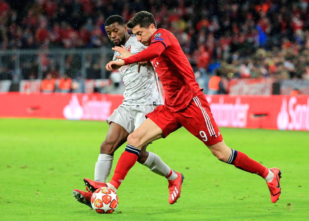 MUNICH, March 14, 2019 - Liverpool's Georginio Wijnaldum (L) vies with Bayern Munich's Robert Lewandowski during the UEFA Champions League 1/8 finals second leg match between Bayern Munich of Germany ...