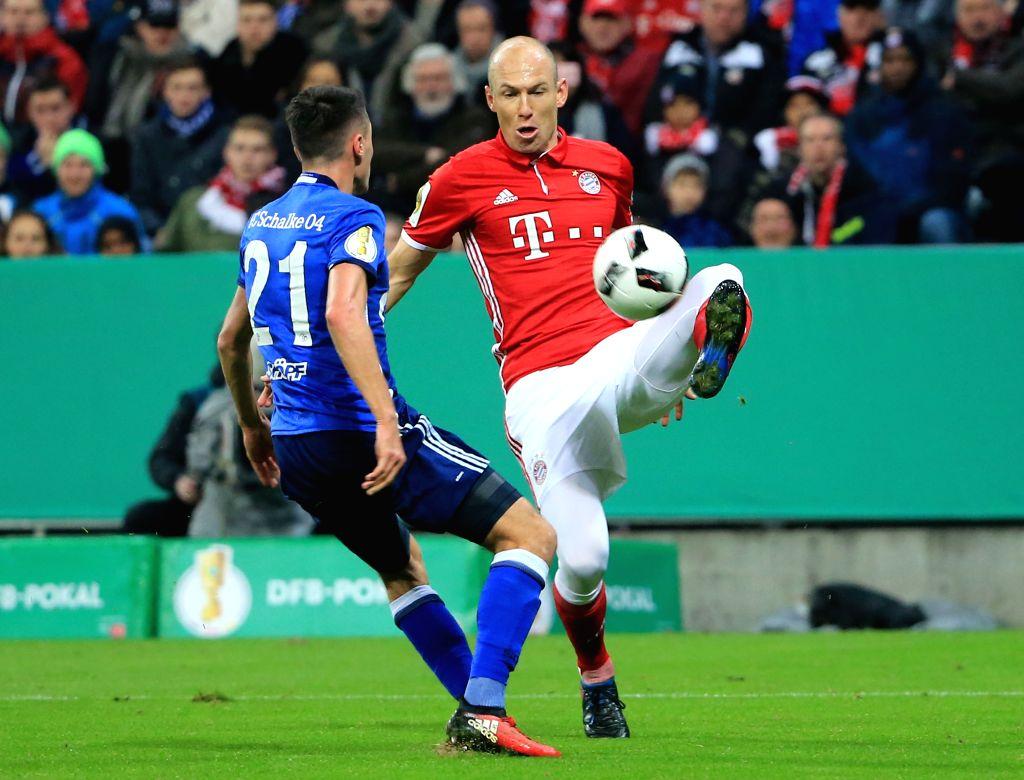 MUNICH, March 2, 2017 - Arjen Robben (R) of Bayern Munich vies with Alessandro Schoepf of Schalke 04 during a quarterfinal football match of German Cup in Munich, Germany, March 1, 2017. Bayern ...