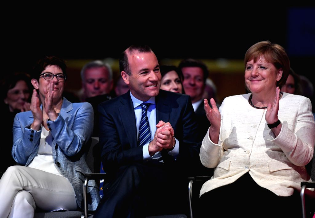 MUNICH, May 24, 2019 - Manfred Weber (C), top candidate of the European People's Party (EPP) for the European elections, German Chancellor Angela Merkel (R) and leader of Germany's Christian ...